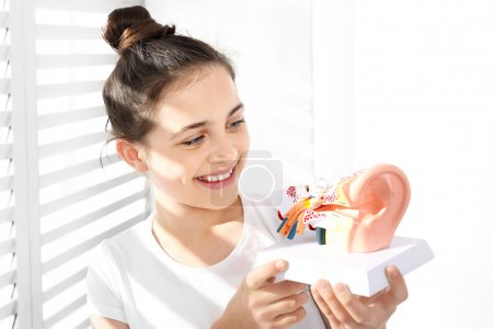 Otolaryngologist, the selection of a hearing aid for a child.