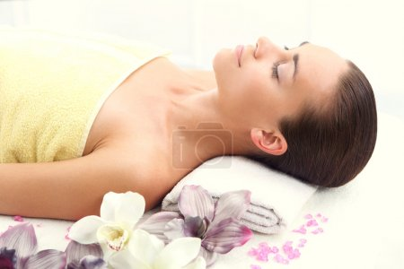 Portrait of a beautiful woman in a beauty salon, relaxation, luxury, peace