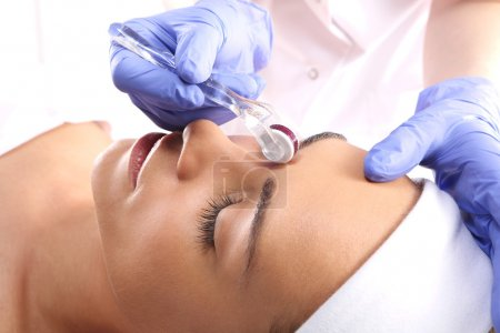 Mesotherapy microneedle, the woman at the beautician