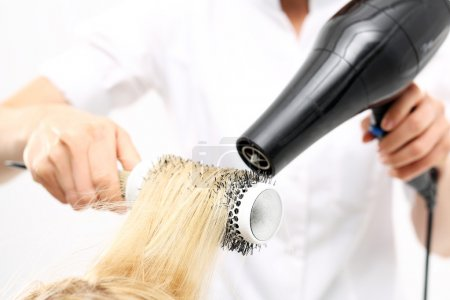 Medium-length hair, hairdresser models hair brush