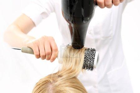 Combing the hair drying brush