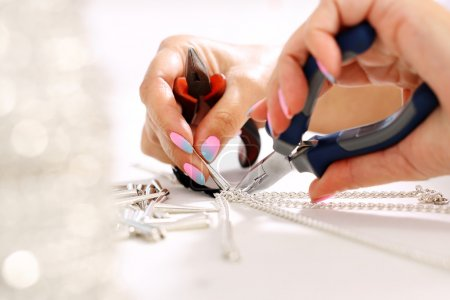 Photo for Female hand performs jewelery - Royalty Free Image
