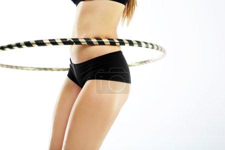 Circle hula hoops, a way to a flat stomach.