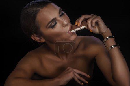 Beautiful woman with chocolate.