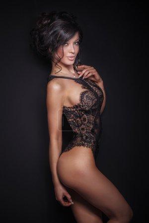 Elegant brunette lady in lingerie.