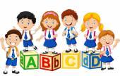 Happy school kids with alphabet block