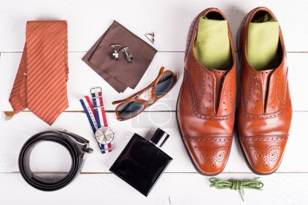 Foto de Man's style, urban shoes, socks and accessories on wooden table - Imagen libre de derechos