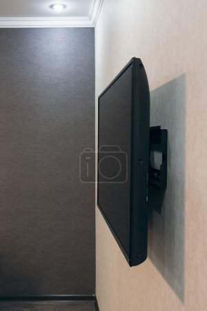 Photo for Big LCD TV mounted onto empty wall, side view - Royalty Free Image
