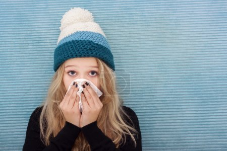 Sick teenager girl with flue
