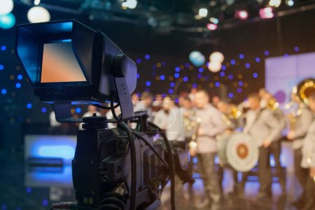 Photo for Television studio with camera and lights - recording TV show. Shallow depth of field - focus on camera - Royalty Free Image
