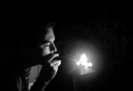 Man getting a light from cigar