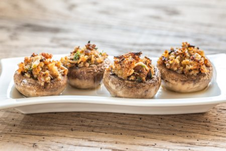 Mushrooms' caps stuffed with cheese, onion and bre...