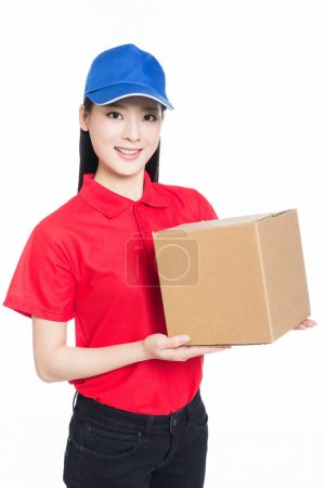 delivery woman carrying cardboard box