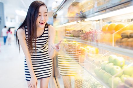 chinese girl and fresh fruit