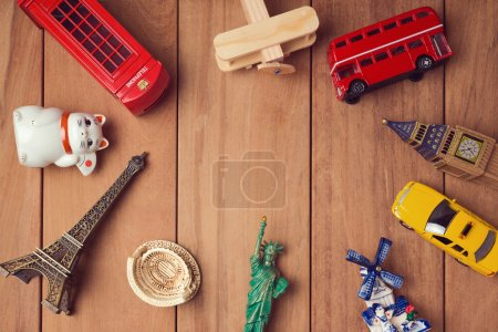 Photo for Travel and tourism concept with souvenirs from around the world. View from above - Royalty Free Image