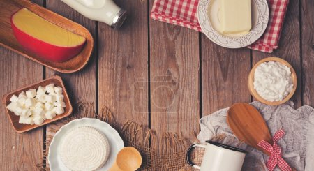 Photo for Wooden table with milk and chesse products. Healthy eating concept. Place for text. View from above. Flat lay - Royalty Free Image