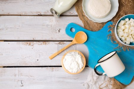 Photo for Milk and cottage cheese with cutting board on rustic background. View from above. Flat lay - Royalty Free Image