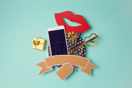 Smartphone with cardboard banner and gift