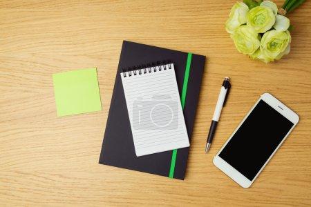 Notebook and smartphone on modern desk