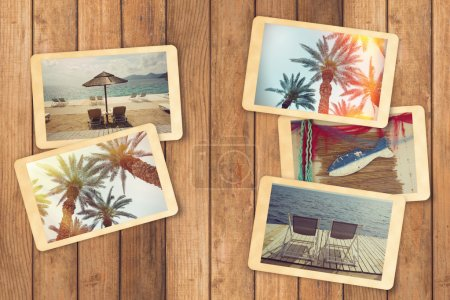 instant photos on wooden table