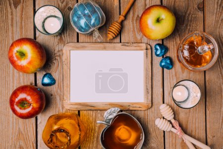 Photo for Jewish holiday Rosh Hashana poster mock up template with honey and apples on wooden table. View from above. Flat lay - Royalty Free Image