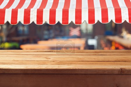 Wooden table with awning