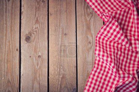 Wooden old table with checked tablecloth