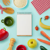Food background with blank notebook