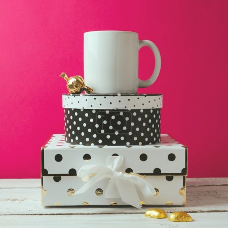 Photo for Coffee cup mock up with polka dots boxes and chocolate - Royalty Free Image