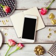 Smartphone mock up with feminine objects. View fro...