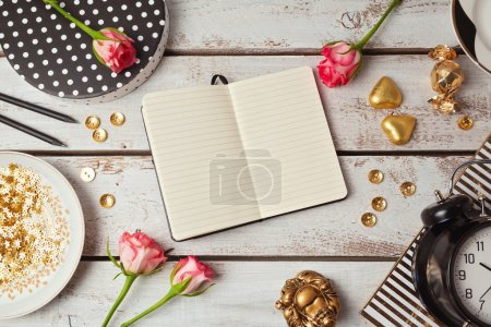 Notebook mock up with feminine objects