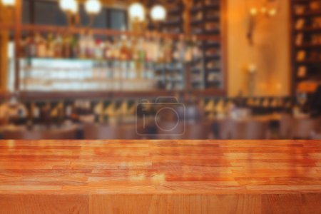 Wooden table over blurred bar