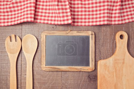 tablecloth, chalkboard and kitchen utencils