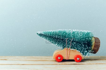 Photo for Christmas tree on toy car. Christmas holiday celebration concept - Royalty Free Image