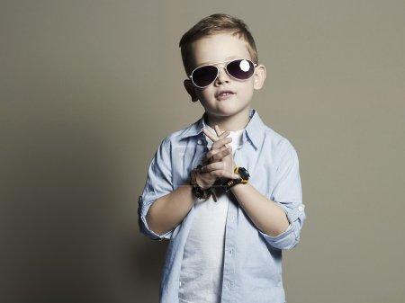 Funny child.fashionable little boy in sunglasses.fashion