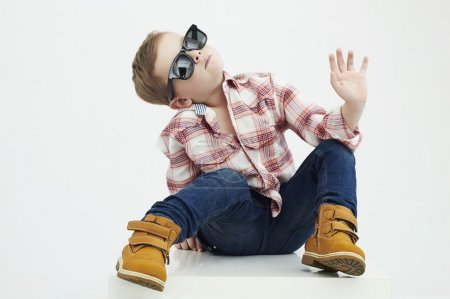 Photo for Funny child.fashionable little boy in sunglasses.stylish kid in yellow shoes. fashion children - Royalty Free Image