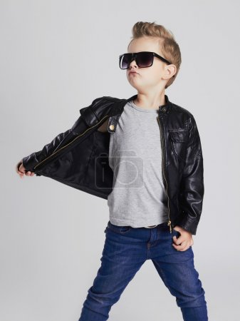 Fashionable child in leather coat.little boy in sunglasses