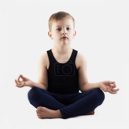 little Boy does yoga