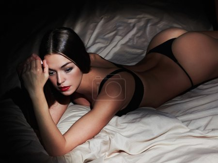 sexy woman posing in bed. Hot woman with perfect slim body
