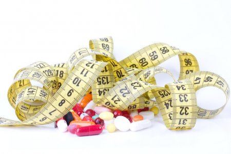 Photo for Measure tape with diet pills - Royalty Free Image