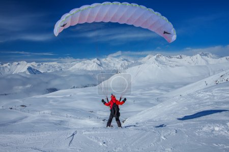 Sky gliding in snowy Caucasus mountains