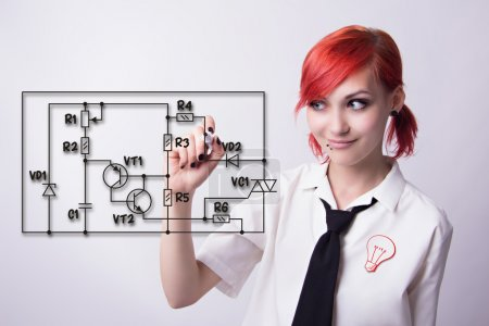 Photo for Red-haired girl, circuitry draws marker, wiring diagram, electronic circuit, in the form of a badge bulb, piercings on his face, he wrote marker, tie and white shirt, student doing homework. - Royalty Free Image