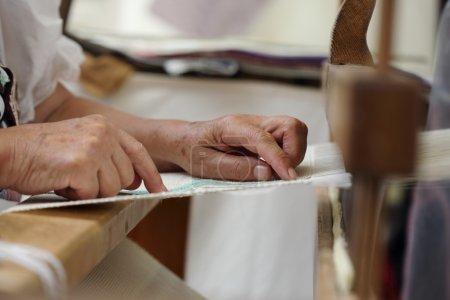Hand loom weaver's hands