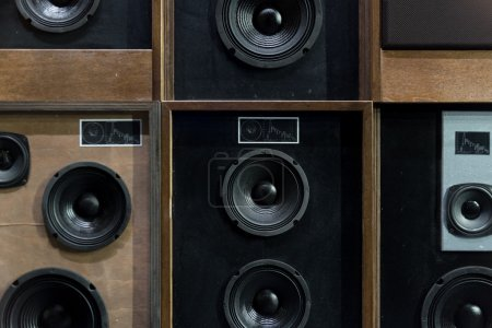 Photo for Old Style Wooden Electronic Music Speakers Stacked Next To Each Other - Royalty Free Image