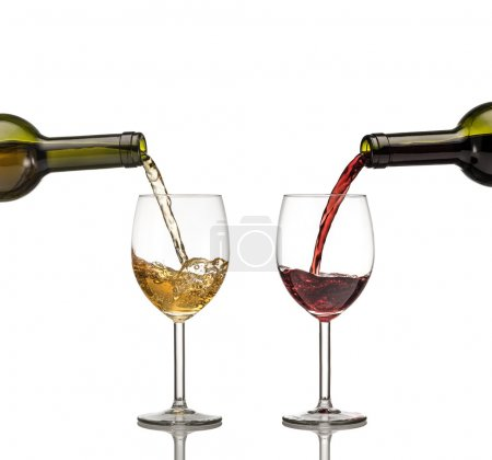 Red and white wine being poured into wine glass on white backgro