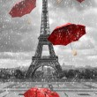 Eiffel tower with flying umbrellas. Black and whit...