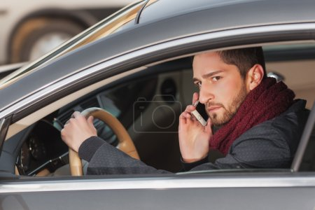 man talking on the phone in the car