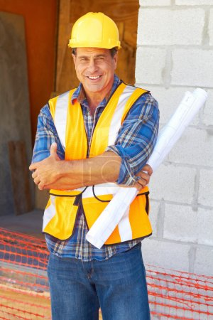 Building contractor with blueprints