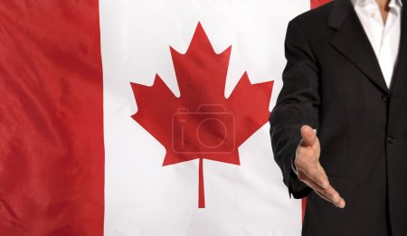 Open hand and Canada flag in the background