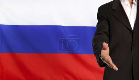 Open hand and Russia flag in the background